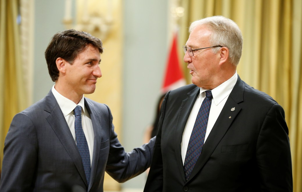 Canada's Prime Minister Justin Trudeau congratulates Bill Blair after he was sworn-in as Minister of Border Security and Organized Crime Reduction during a cabinet shuffle at Rideau Hall in Ottawa, Ontario, Canada, July 18, 2018. REUTERS/Chris Wattie - RC182BD57630