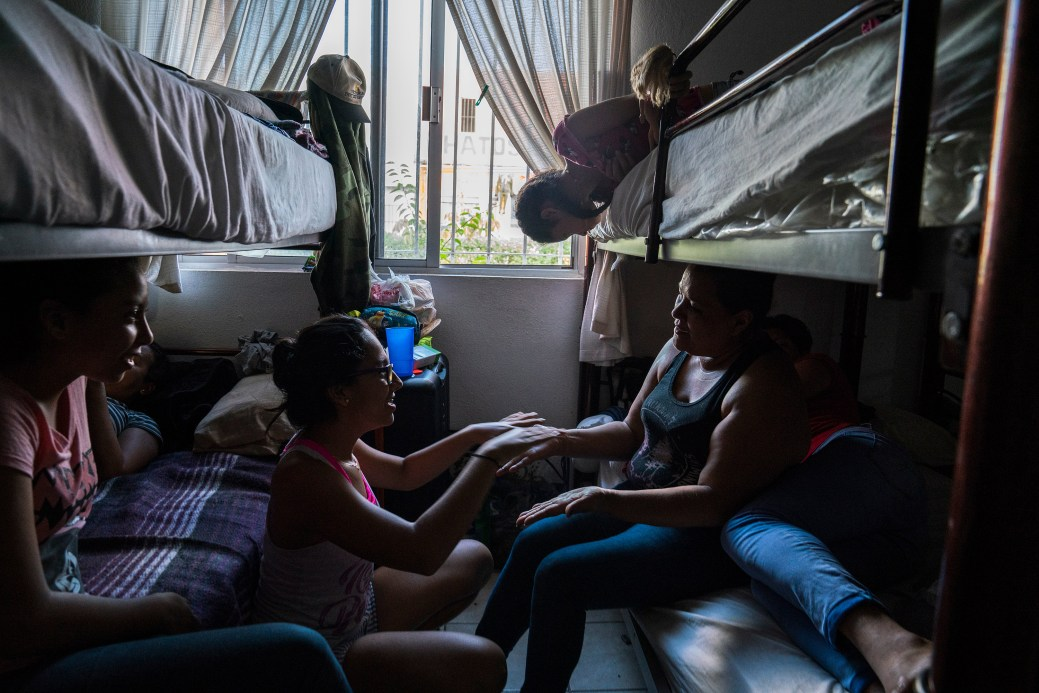 Paula, 14, center, from Colombia, plays with Tania, 42, right, from Honduras in a shelter in Matamoros, Tamaulipas on Nov. 7, 2018. They have been waiting for weeks at the shelter to seek asylum in the U.S. because Customs and Border Protection, CBP, agents have told them that they are at full capacity. Photo: Verónica G. Cárdenas for The Intercept