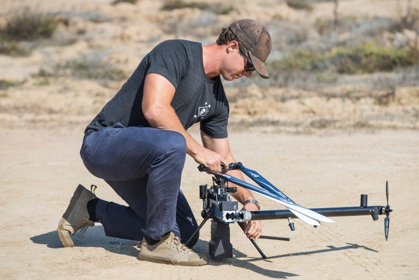 Scott Sanders, head of operations for Anduril Industries, prepares a Lattice Modular Heli-Drone for a test flight at the Red Beach training area, Marine Corps Base Camp Pendleton, California, Nov. 8, 2018. The Lattice Modular Heli-Drone was being tested to demonstrate its capabilities and potential for increasing security. (U.S. Marine Corps photo by Cpl. Dylan Chagnon)