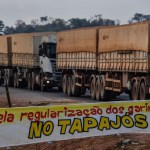 """Truckers line up behind a banner reading """"For the regularization of garimpos (illegal mines) in Tapajos"""", referring to the Tapajos River, on the BR 163 highway, blocked by """"garimpeiros"""" -illegal gold miners- during a protest in Morais Almeida, Itaituba, Para state, Brazil, on September 13, 2019. - Members of an indigenous tribe in the Amazon in northern Brazil on Friday called for wildcat miners to be allowed to prospect for gold on their land, saying it was a source of income. (Photo by NELSON ALMEIDA / AFP) (Photo credit should read NELSON ALMEIDA/AFP/Getty Images)"""