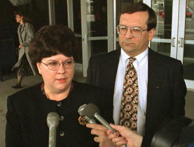 BILLINGS, MT - APRIL 12:  US Attorney for the District of Montana Sherry Matteucci (L) and Assistant US Attorney Jim Seykora (R) talk to the media outside the Federal Building in Billings, MT, after the arraignmet of Agnes Stanton and her son Elbert Stanton 12 April 1996.  The Stantons surrendered to federal authorities 11 April outside the Freemen compound near Brusett, MT.  (Photo credit should read JOHN RUTHROFF/AFP/Getty Images)