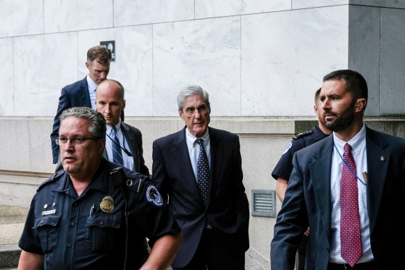 WASHINGTON, DC - JULY 24: Former Special Counsel Robert Mueller (C) departs after testifying to the House Intelligence Committee about his report on Russian interference in the 2016 presidential election on Capitol Hill on July 24, 2019 in Washington, DC. Mueller earlier testified before the House Judiciary Committee in back-to-back hearings on Capitol Hill. (Photo by Alex Wroblewski/Getty Images)