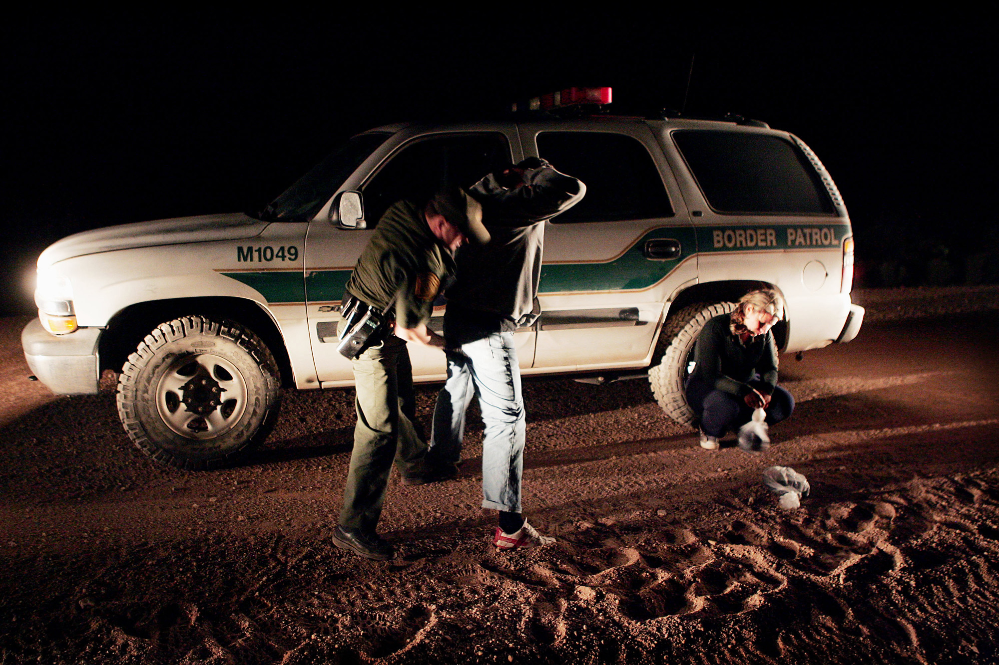 DOUGLAS, AZ - APRIL 4:  Border Control Agent Jason Huberd searches migrants captured near the border April 4, 2005 near Douglas, Arizona. Illegal immigration in the region has slowed over the past few days, partly due to the presence of volunteers from the Minuteman Project. The projects participants are expected to fan out across a 23 mile stretch on the Arizona side of the border to search for Illegal aliens who are making the trek into the U.S. from Mexico. (Photo by Scott Olson/Getty Images)