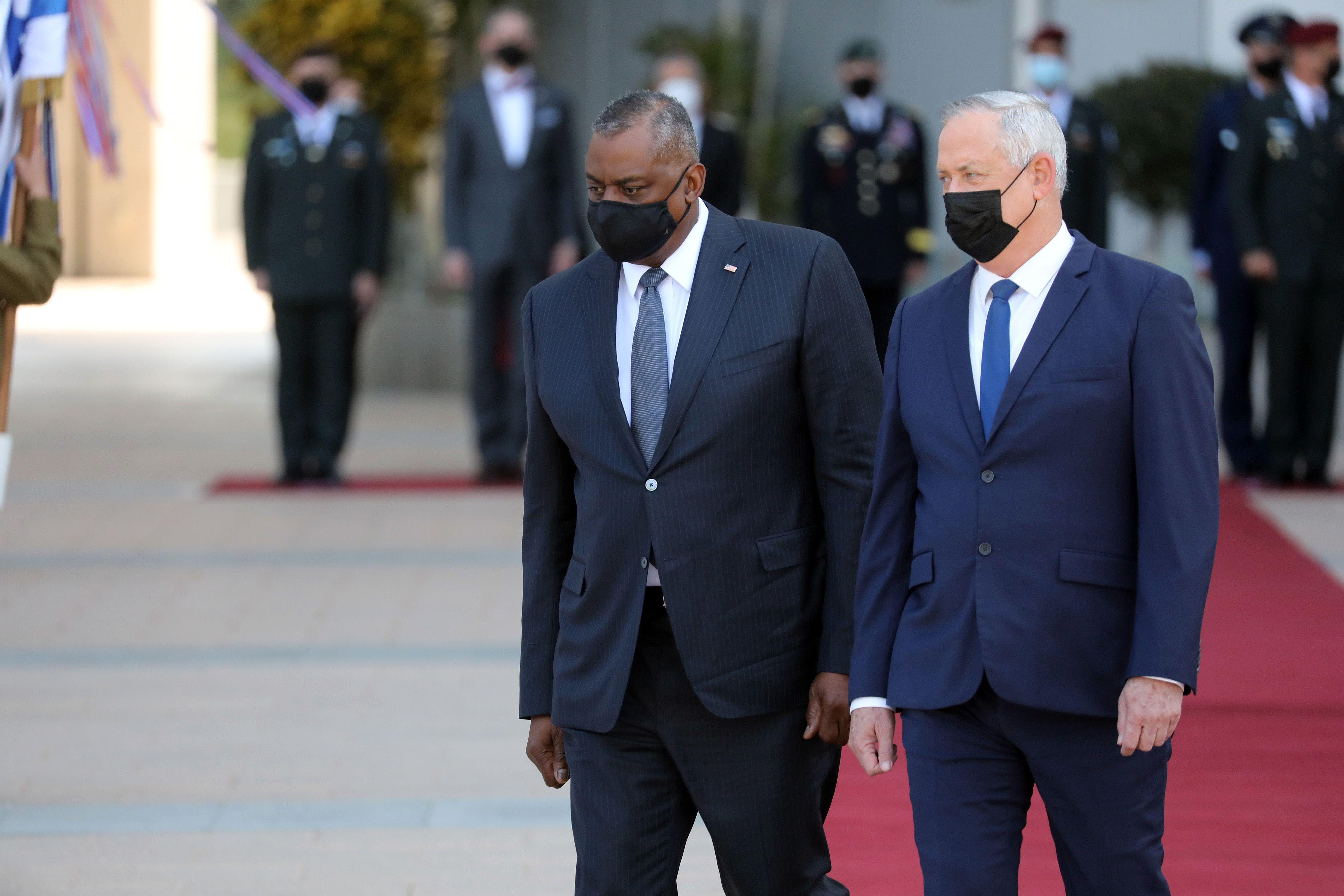 U.S. Defense Secretary Lloyd Austin (L) and Israeli Defense Minister Benny Gantz are seen at a ceremony at the Kirya military base in Tel Aviv, Israel on April 11, 2021.