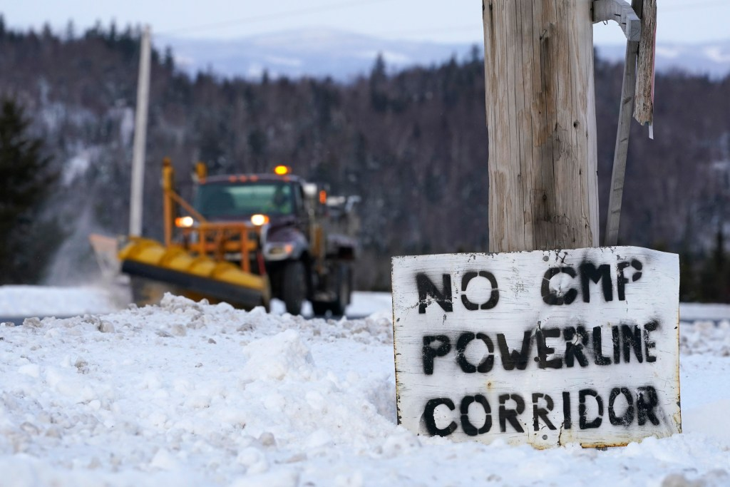 A sign in protest of Central Maine Power's controversial hydropower transmission corridor is displayed along Rte. 201 near The Forks, Maine, on Feb. 9, 2021.