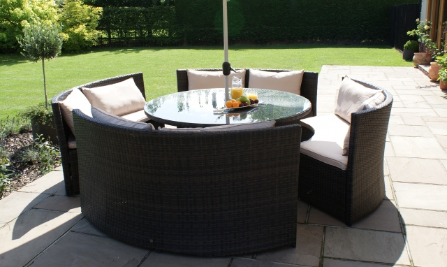 The Latest Garden Furniture From Fishpools | BARBUDA - Round Sofa Garden Dining Set - Brown Rattan Plus Free Lazy Susan - Circular table and chair garden furniture which creates a more intimate setting and is space saving too.