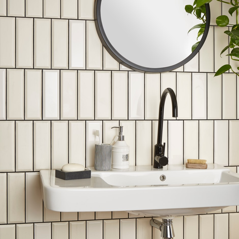 The Versatile Brick Tile & How To Use It | offset vertical modern tile layout in a bathroom space draws the eye upwards and creates the illusion of height to low ceiling spaces.