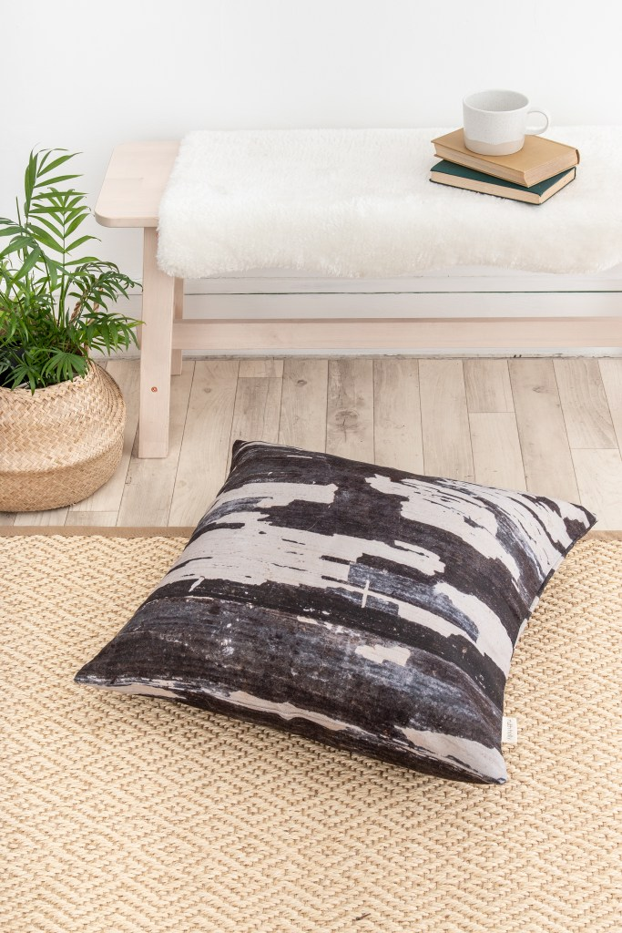 Ruth Holly designs home accessories such as this cushion cover which encompass earthy tones, patterns and organic markings from nature itself.