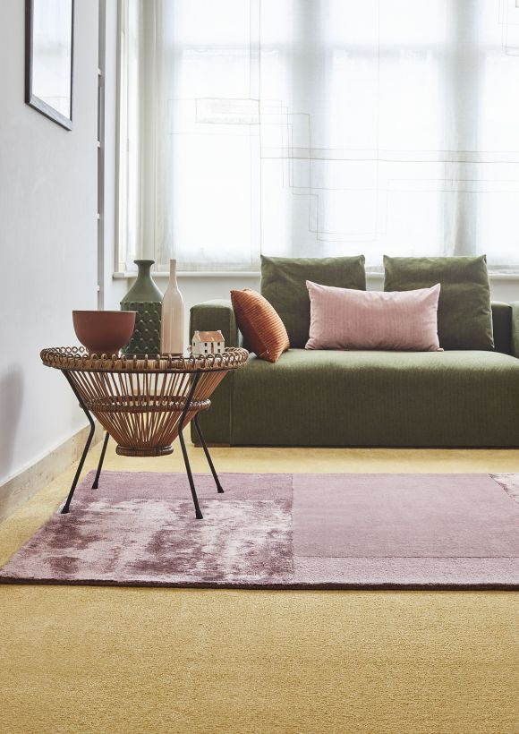 Why You Should Consider Carpet For Your Homes | Modern living room using carpet to add colour and texture making a wonderful backdrop to layering rugs. Providing sound absorbing and insulating qualities to the home. Mustard Honey carpet from Carpetright