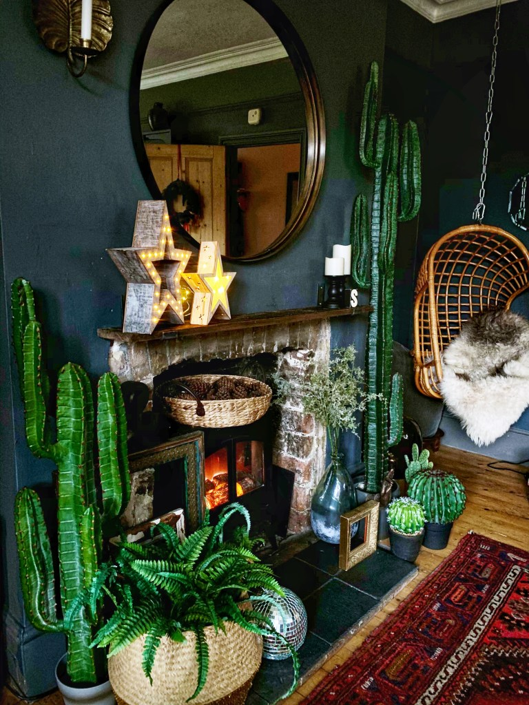Bohemian, Dark & Inviting Home of Nadia Martini | Boho living room fireplace