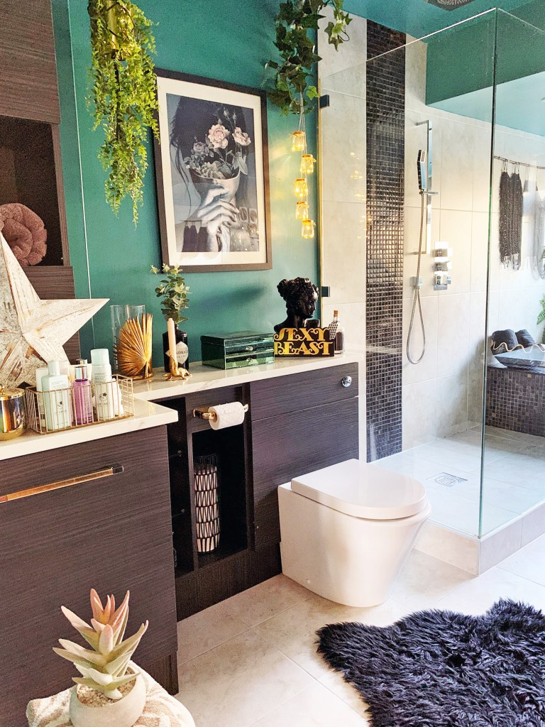 The Glamorous Colourful & Pattern Filled Home of Cara Baker | bathroom design with touches of gold accessories and art to create interest and add character
