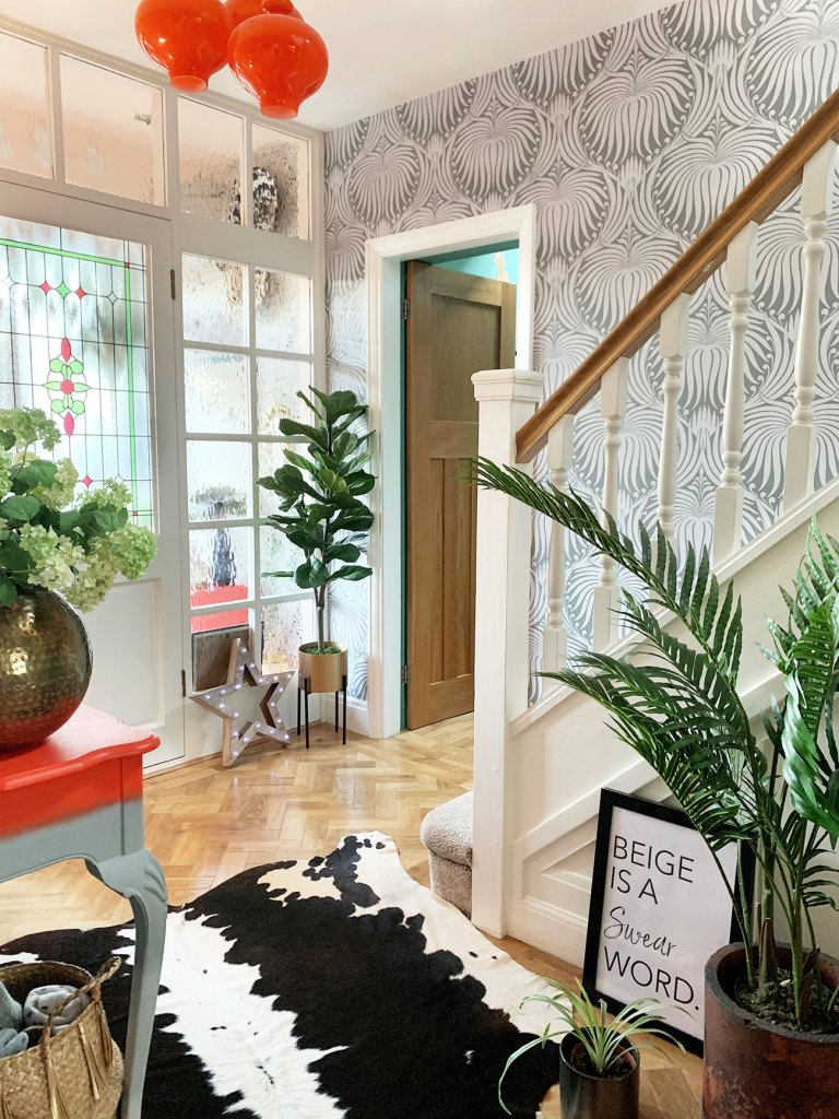 The Glamorous Colourful & Pattern Filled Home of Cara Baker | Pattern and pops of vibrant colour add character and personality to Cara's entrance hallway