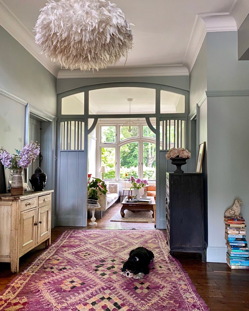 Arts & Craft entrance hall with vintage finds and oversized ostrich feather pendant