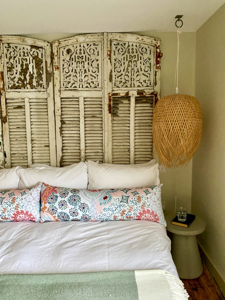 Fishermans Cottage bedroom using vintage shutters with newer decor and subtle colour palette