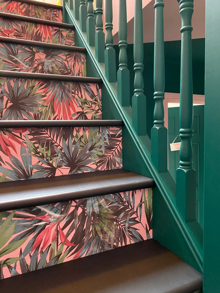 Bold botanical wallpaper and colour have been used to create statement staircase | Colour & Pattern Filled Eclectic Home - Saara McLoughlin