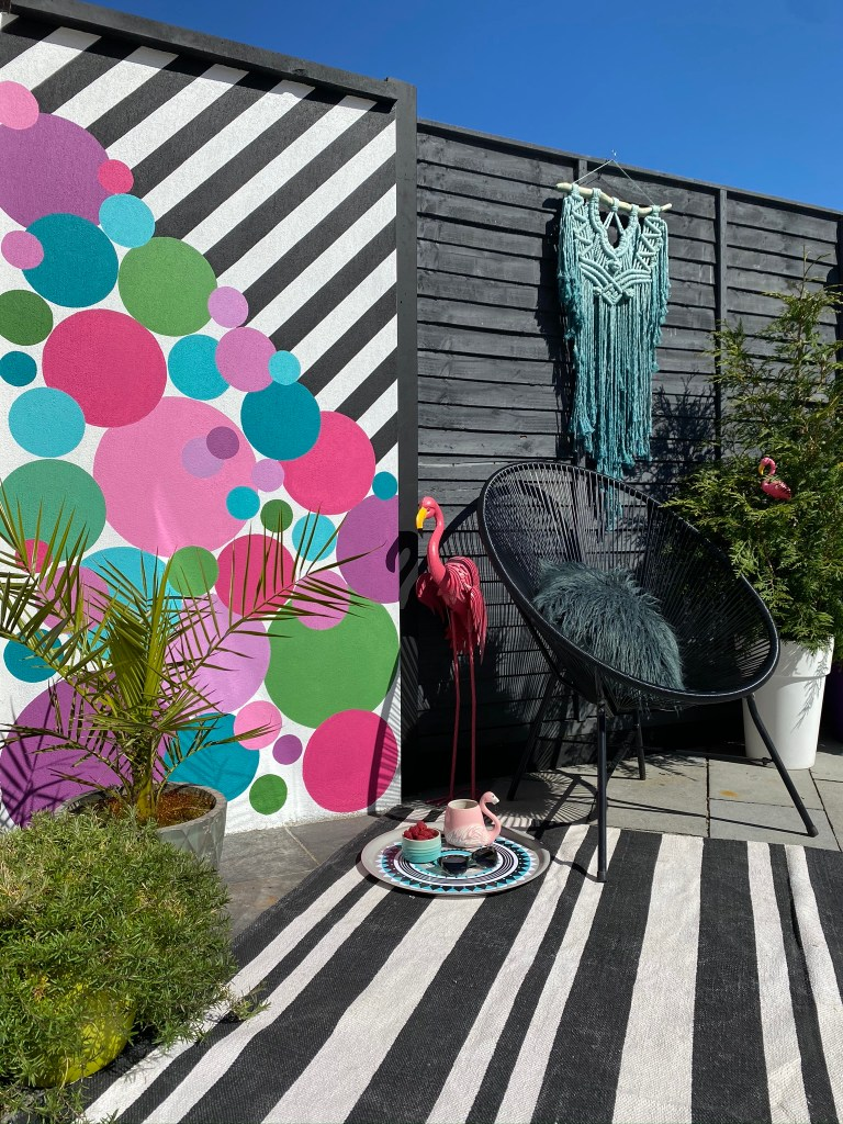 Bold colourful graphic decor continues in Saara's outdoor garden space. Colour & Pattern Filled Eclectic Home -  Saara McLoughlin