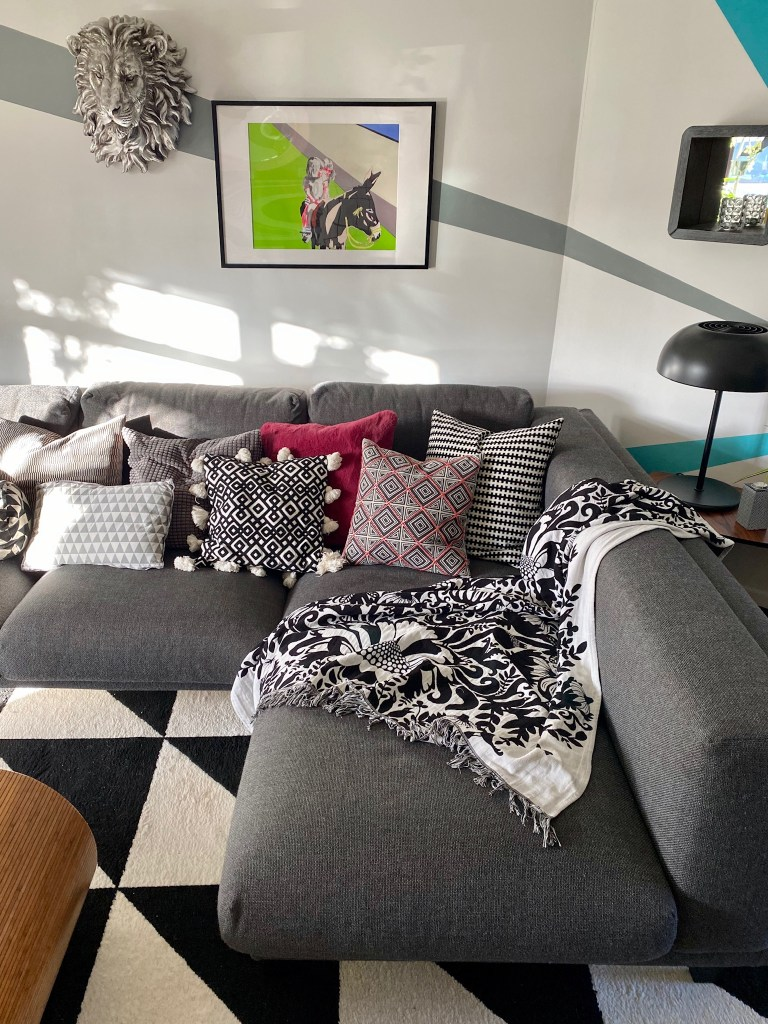 Colour & Pattern Filled Eclectic Home - Saara McLoughlin living room area uses colour blocking and textures to create interest
