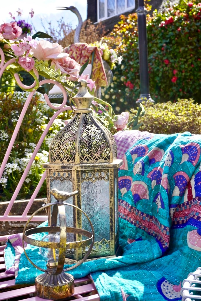 Easy Styling Tips For Your Garden Seating Areas - Lanterns provide ambient lighting for evenings in. the garden. Together with a throw you'll linger longer too.