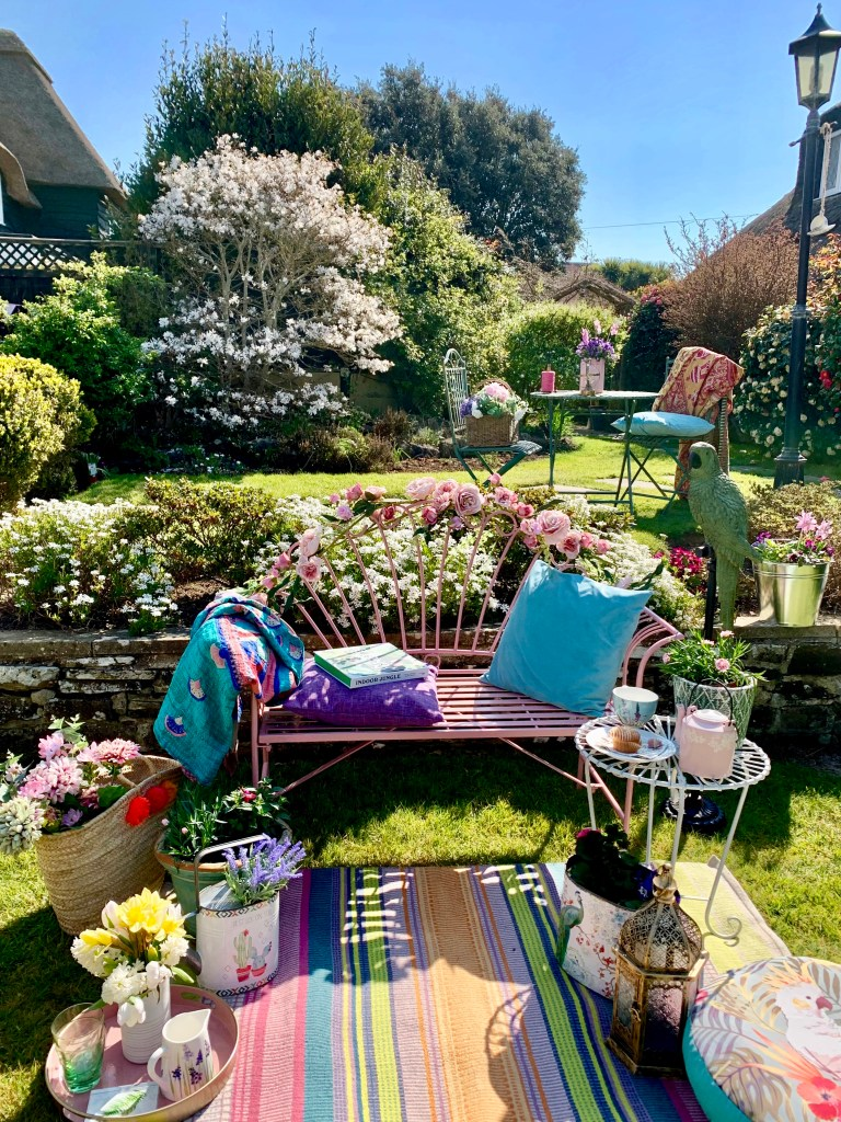 Easy Styling Tips For Your Garden Seating Areas - Cottage garden pink bench seating area styled for smaller gatherings
