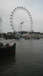 Admiring the London eye from Embankment.