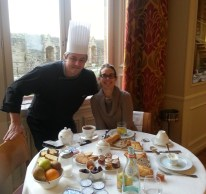 Anne having breakfast with the head chef at the La Mére Poulard