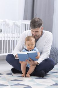 caucasian-man-reading-to-baby