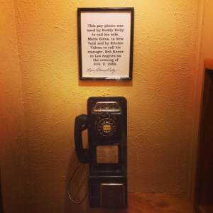The lonely payphone now sits behind glass under lock and key. Used by both Buddy Holly and Ritchie Valens before making their way to the small airfield to catch their flight to Moorhead, MN. At the Surf Ballroom in Clear Lake, IA.