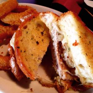 The old man's pick. The Pub Melt at Scorz Bar and Grill in Mount Vernon, IA. Tender grilled pork tenderloin and onions with melted Swiss cheese, in between toasted buttery garlic bread. Big belly approved!