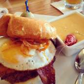 I give you.... the Dirty Canary from Prairie Canary in Grinnell. A burger with cheddar cheese, BBQ pulled pork, bacon and a fried egg! And by its side is the best soup I've ever had in the state of Iowa. A Bayou Potato Soup with Crawfish tails. Geaux seek this out! https://www.facebook.com/prairiecanary