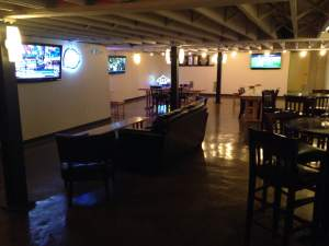 Couches, high top tables, flat screen TVs and a full bar. What else do you need? The Canary Underground in Grinnell, IA.