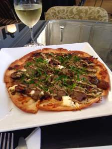 Meet your new best friend, amigos. The housemade potato dough is used for the crispy crust and is topped with duck confit,  mozzarella, goat cheese, fresh basil, stone ground mustard and balsamic onion. I think we may have covered all of the 7 deadly sins in this one dish.  https://twitter.com/LadoraBistro