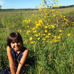 Late September in rural Iowa. Gigi finding her wild (flower) side. Near Sharon Center, IA.