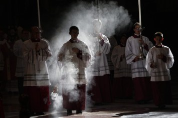 Altar boys arrive in procession during a mass celebrated by Pope Benedict XVI to commemorate cardinals and bishops who died this year, at the Vatican