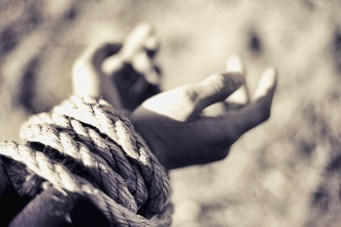 Persecution_hands_tied