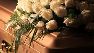 death-coffin-flowers-e1407529777381