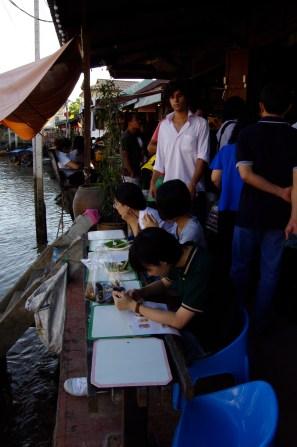 Eating at Amphawa Floating Market