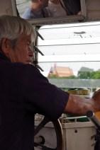 boat driver chao praya river bangkok