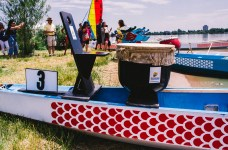 """DENVER,Colo.-July 20, 2014-A pair of Taiwan-style dragon boats rest on the shore of Sloan's Lake. This was the 14th year for the festival and more than 100,000 people attended. """"The mission of the Colorado Dragon Boat Festival is to build bridges of awareness, knowledge and understanding between the diverse Asian Pacific American (APA) communities and the general public through cultural education, leadership development, and athletic competition"""""""