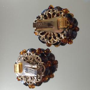 Hobé clip back mechanism with roller disk.