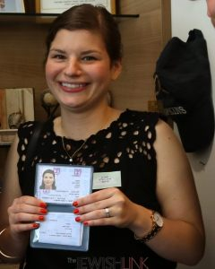 Becky showing her Teudat Zehut (Israeli citizenship card) today after her arrival in Israel.Photo Credit: Sasson Tiram, courtesy of Nefesh B'Nefesh.