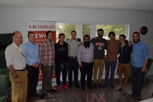 Miami-L to R Dr. John Grossman Chairman of LIBI USA, IDF Captain Oron Kalmanzon and Chabad Rabbi Mendy Fellig along with UM College Students