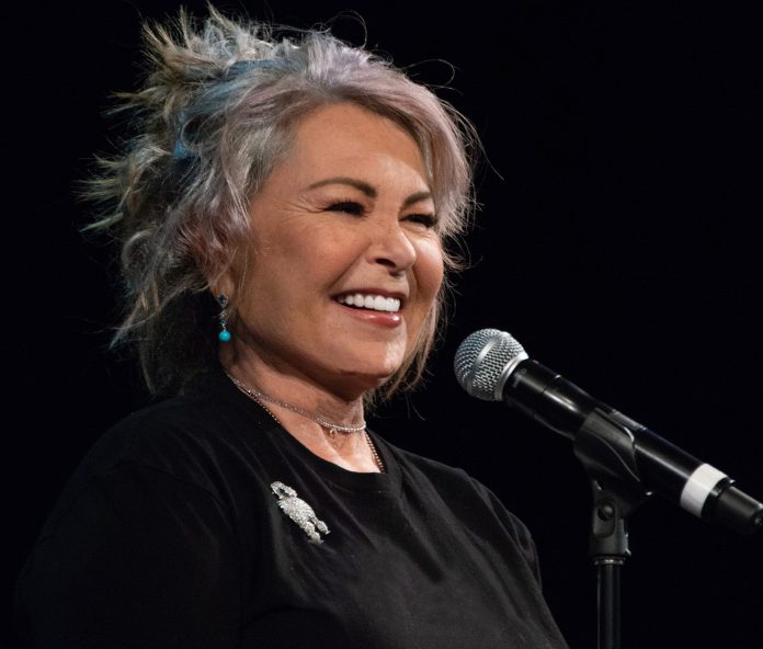 Roseanne Barr on the microphone