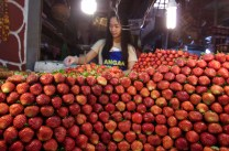 A pile of fresh strawberry carefully arranged by a fruit vendor inside the public market in Baguio City. Farms from different provinces of Benguet, north of Philippines, are one of the major supplier of fresh strawberries all around the country.