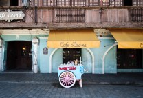 """A """"sorbetero"""" or ice cream vendor takes a break under a shade in one of the ancient Spanish-era buildings along Calle Crisologo in Vigan City, north of Philippines."""
