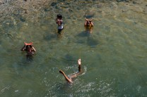 Children enjoys a dip at the Chico River located in Bontoc, Mt. Province to cool themselves down from the scorching summer heat.