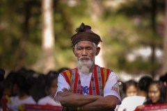 An elder of Sagada in Mountain Province, Philippines, awaits his turn to chant his prayers during the opening ceremony Sagada's Etag Festival. 'Etag' is a salty preserved piece of pork that is either sun-dried or smoked.