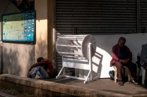 An elderly man and a drunk one are seen taking a nap along the People's Park in Baguio City.