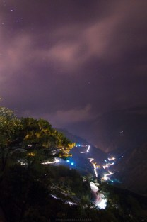 The zig-zag road of Kennon in Baguio City glows, illuminated by traveling vehicles, while a storm is coming.