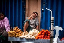 A street food vendor takes a nap without anyone supervising his goods along the streets of Baguio City.