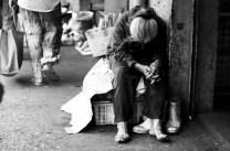 An elderly street vendor takes a nap just along the public market in Baguio City.